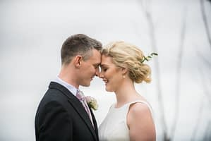Bride and groom touching heads, Peppered Pig wedding, Snaith