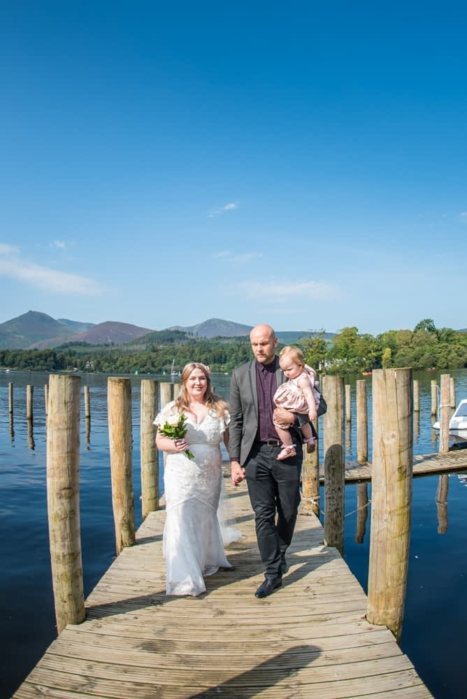 Walking down the jetty, Derwentwater Rock the Dress, Lake District wedding photographer