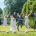 Bridal party jumping at Wortley Hall in Sheffield