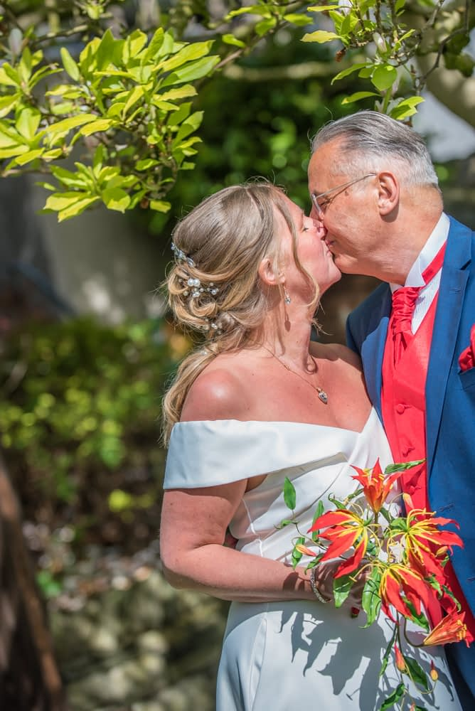 Kisses for bride and groom, elopement wedding Lake District