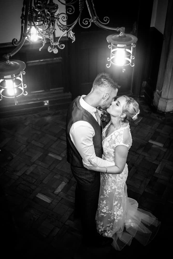 Kisses inside the register office,  wedding photographers Carlisle register office elopement wedding Lake District