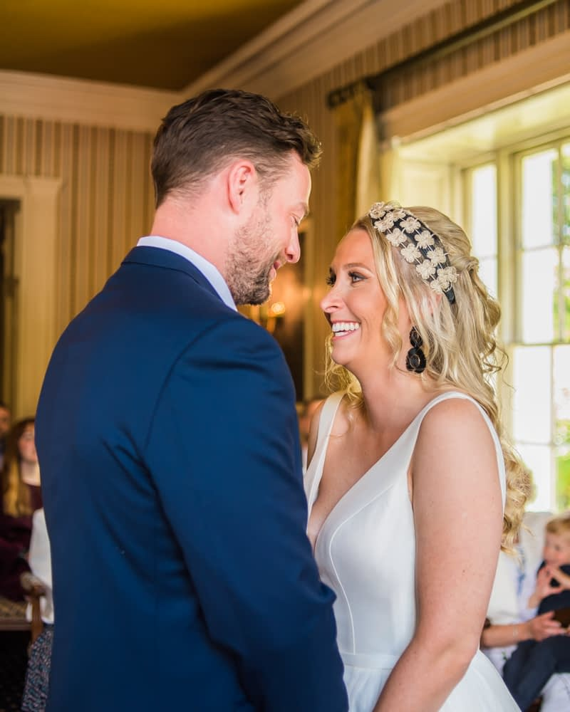 Happy smiling bride and groom, Overwater Hall wedding, Lake District