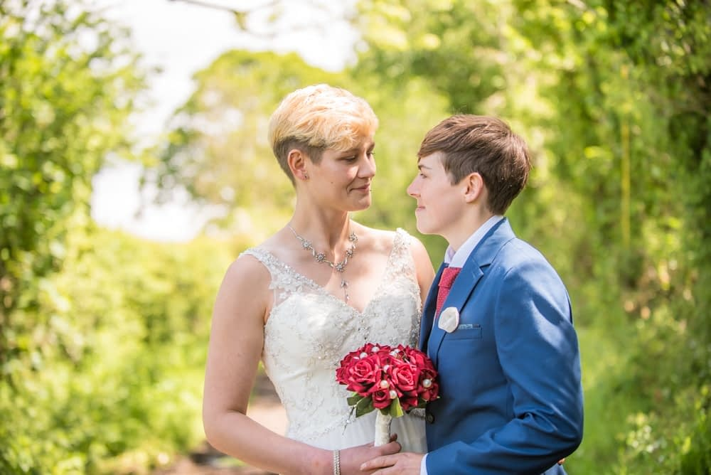 In countryside lane, Carlisle Register office, Lake District wedding photography