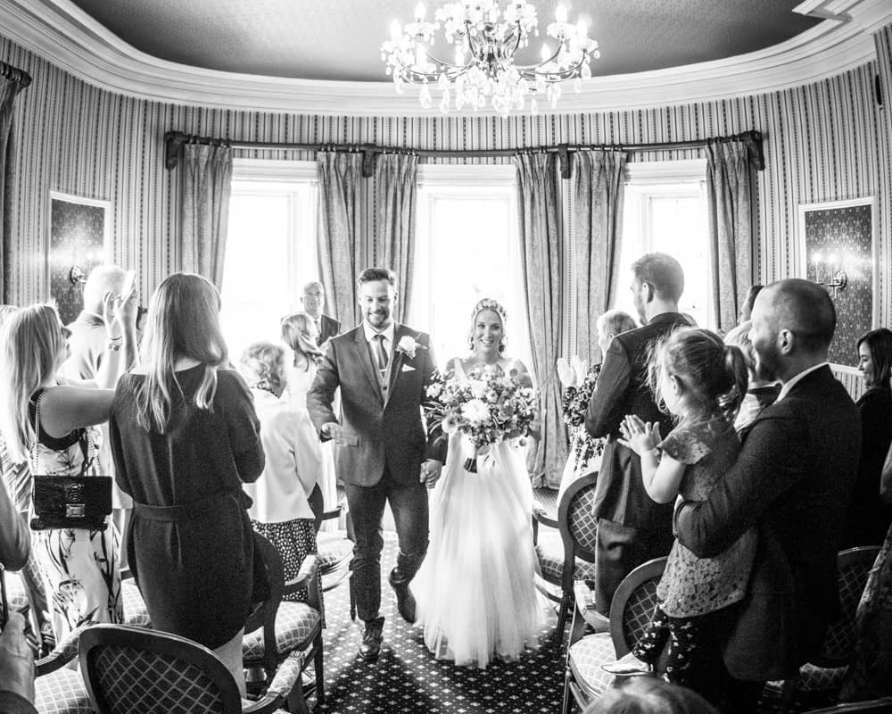 Walking out of ceremony, Overwater Hall wedding, Lake District
