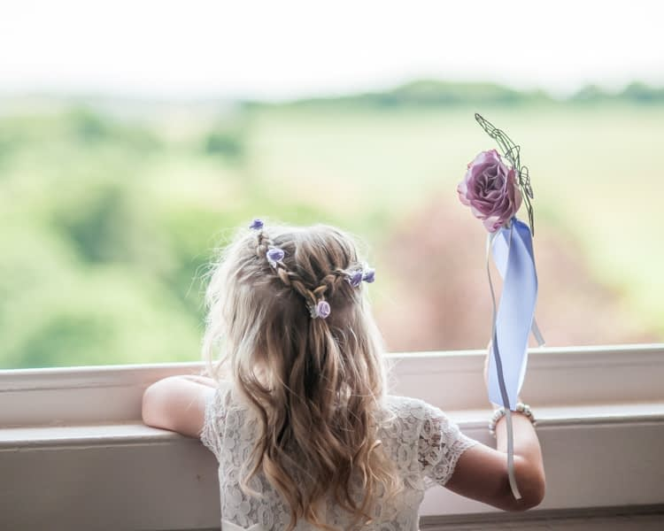 Flower girl looking out of window at Wortley Hall