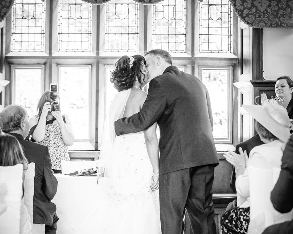 First kiss during ceremony, Whitley Hall weddings, Sheffield wedding photographers