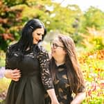 Smiling at each other in front of flowers, Botanical Gardens pre-wedding portraits Sheffield