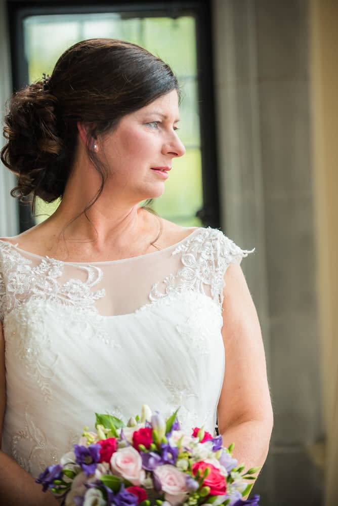 Bride looking out of window, Lingholm wedding, Lake District
