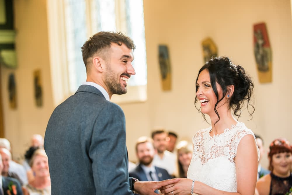 Laughing during ring exchange, Sheffield wedding photographers