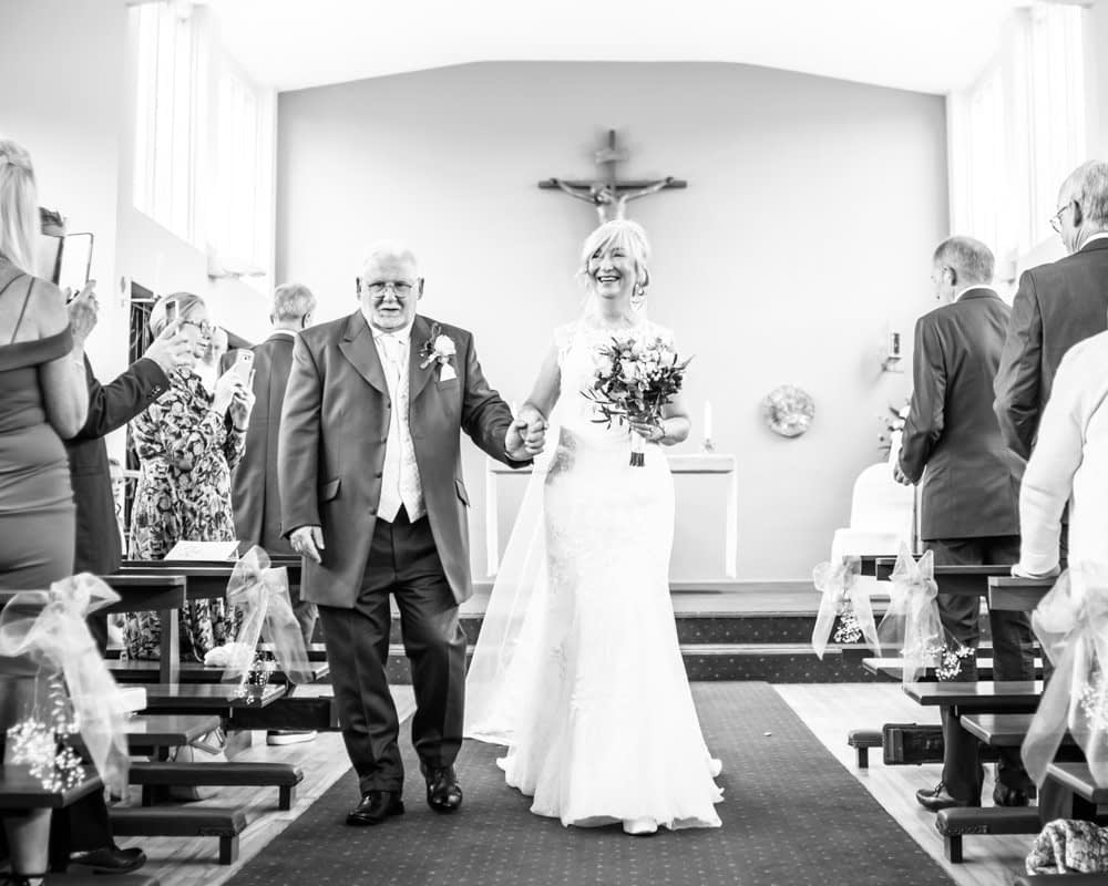 Bride and groom walking down the aisle,  Hotel Van Dyk wedding photography Chesterfield