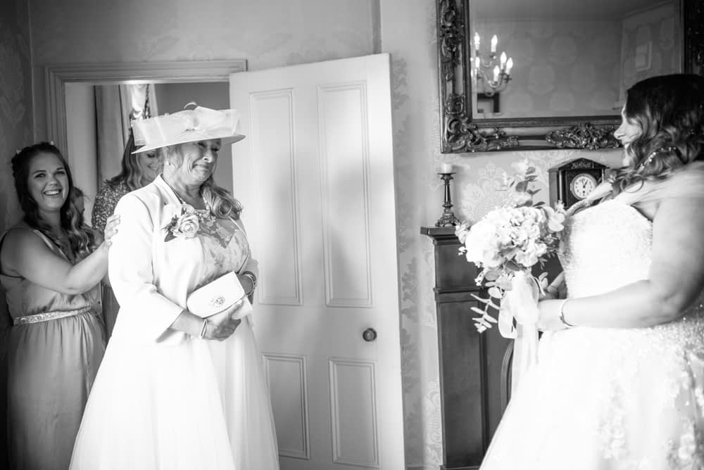 Bride's mum seeing her in dress, emotional