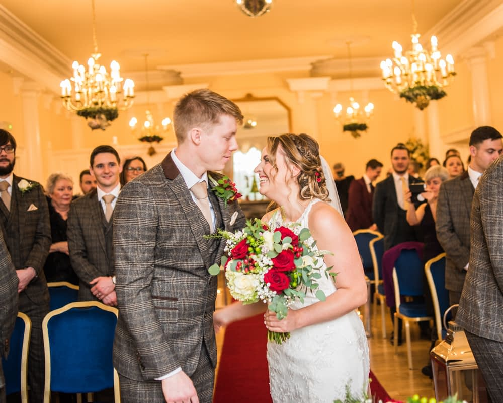 Laughing together in ceremony, Grange Hotel, Lake District wedding photography
