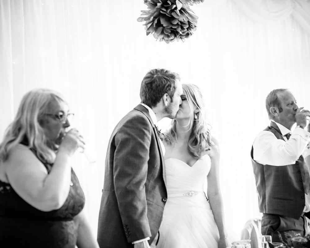 Kiss at end of speeches, Maynard wedding, Sheffield photographers