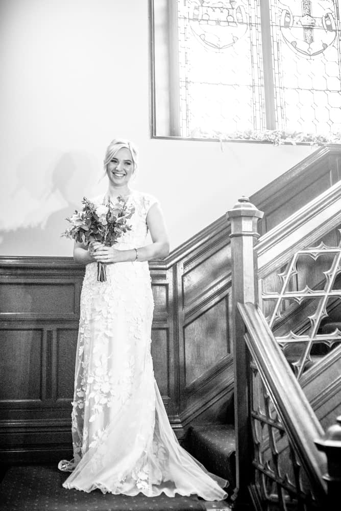 Alex on the staircase,  wedding photographers Carlisle register office elopement wedding Lake District