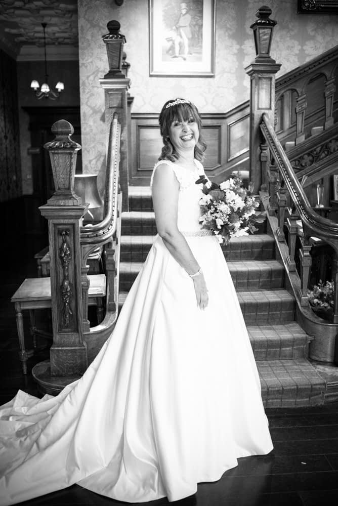 Judith at the bottom of the staircase, Merewood Country Hotel Hotel weddings, Lake District