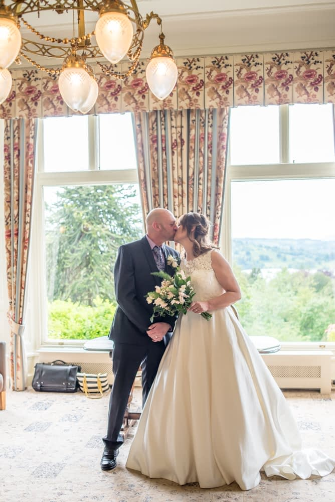 Kiss before leaving ceremony, Merewood Country Hotel Hotel weddings, Lake District