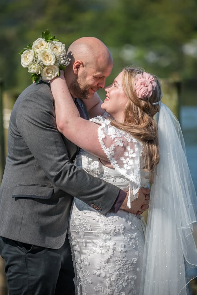 Touching noses, bride and groom, Derwentwater Rock the Dress, Lake District wedding photographer