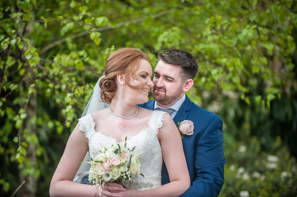 Bride and groom cuddle, Chesterfield wedding photographer, Casa Hotel