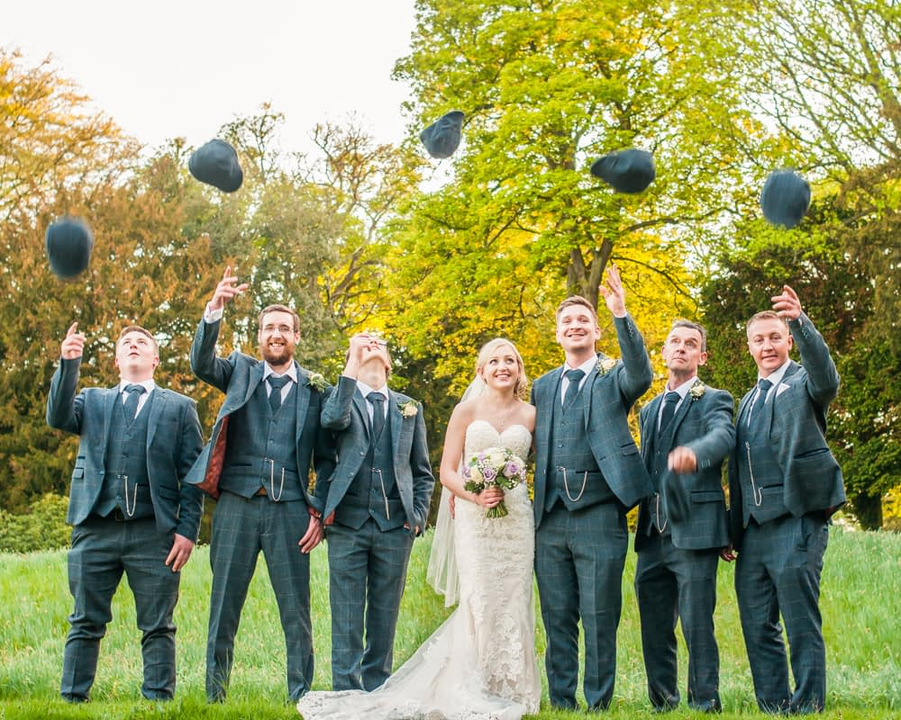 Groomsmen flat cap toss at Yorkshire wedding in Wortley Hall, Sheffield