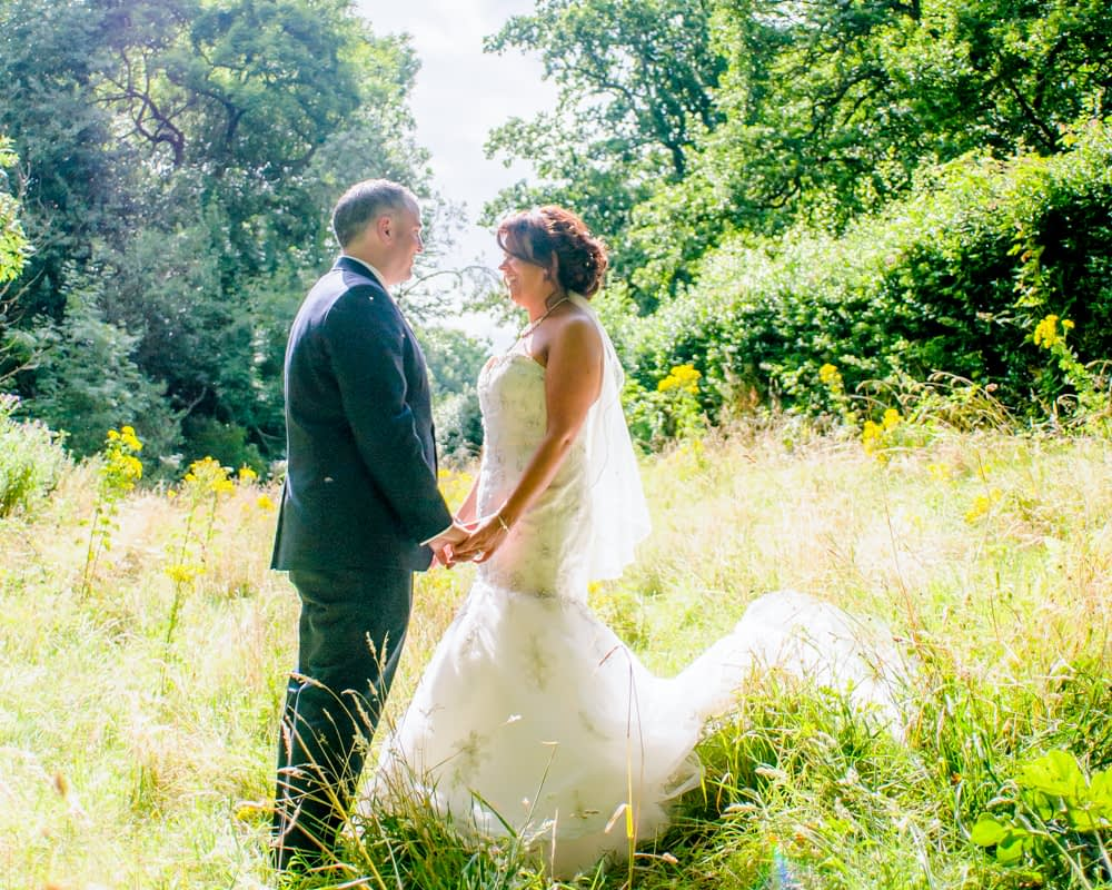 Outside in grounds, meadow, Whitley Hall weddings, Sheffield wedding photographers