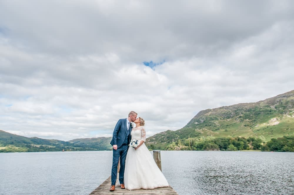 Bride and groom kissing, Inn on the Lake, Ullswater, Lake District documentary wedding photographers