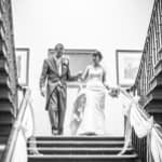 Bride and groom on stairs at Wortley Hall in Sheffield