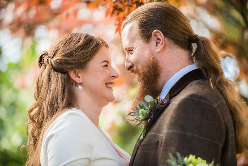 Looking at each other in leaves, Greens at Gretna wedding, Gretna wedding photographers