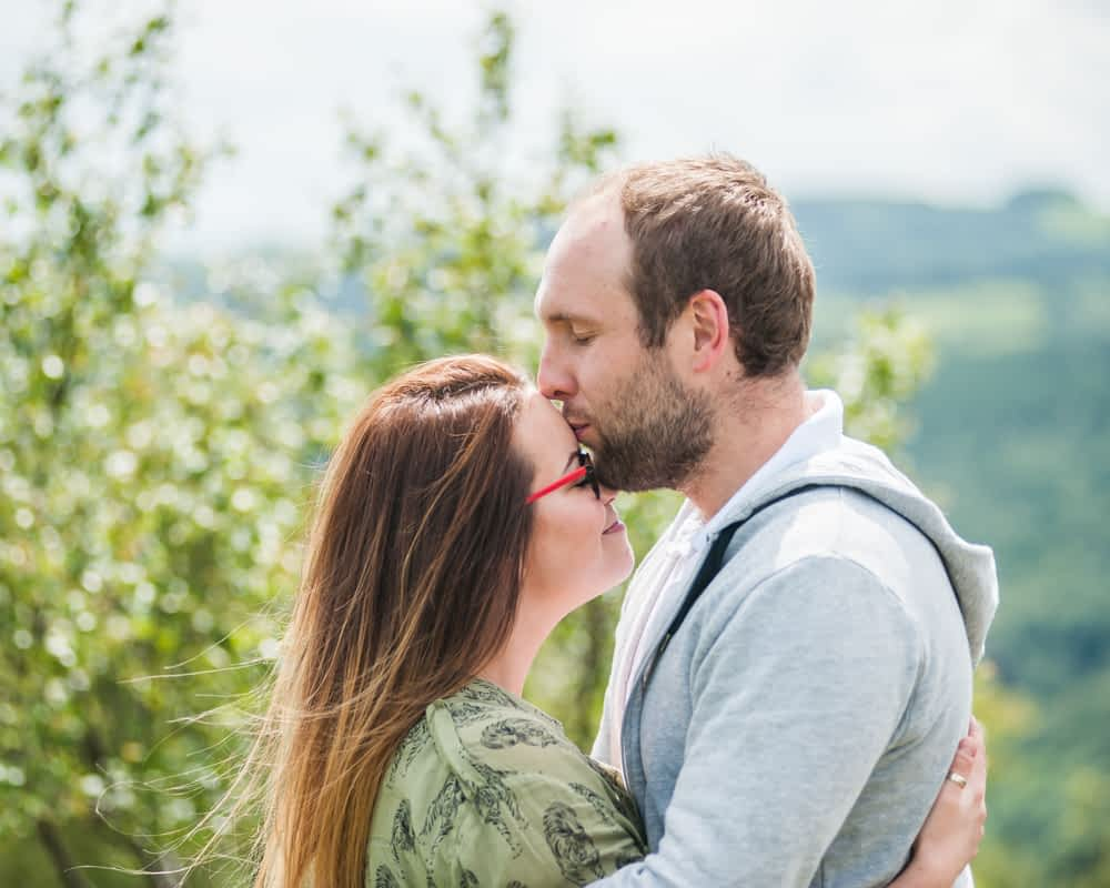 Max kissing Louisa on head - Sheffield wedding photographers