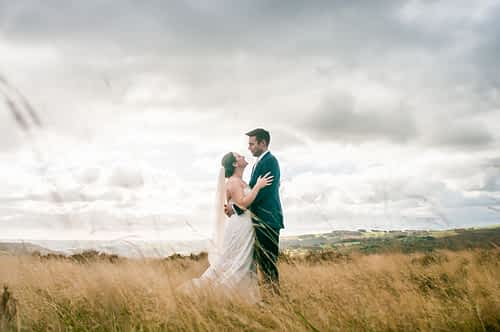 Long grass wedding couple in the Peak District