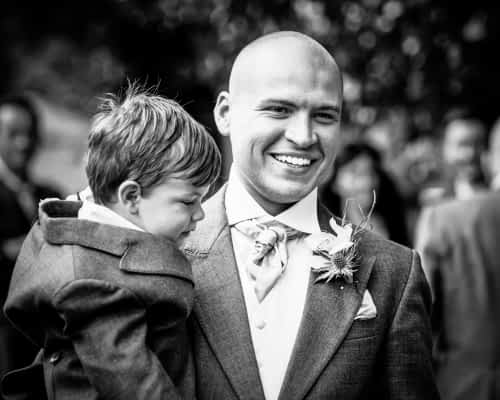 Groom with son walking to church, Sheffield wedding photographers