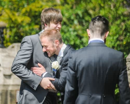Groom and best man laughing, Sheffield wedding photographers