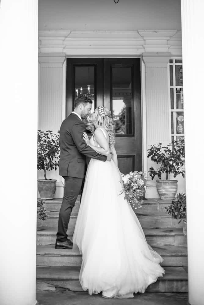 Bride and groom kissing, Overwater Hall wedding, Lake District