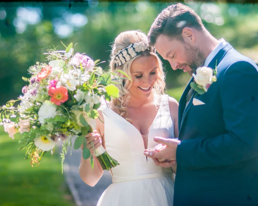 Natural moments admiring rings, Overwater Hall wedding, Lake District