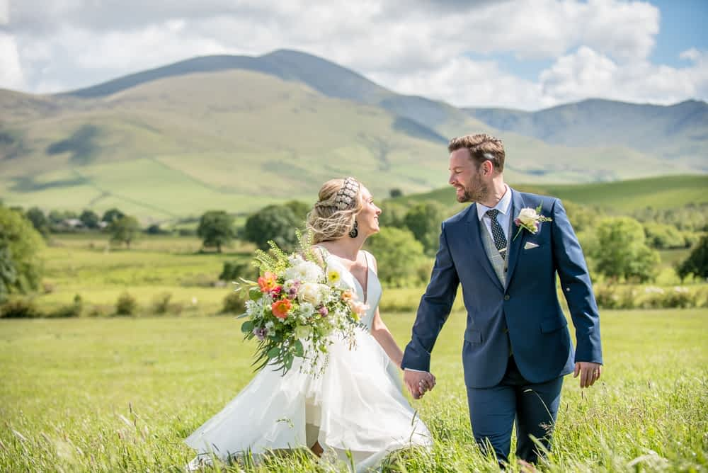 Laughing with views of Skiddaw, Overwater Hall wedding, Lake District