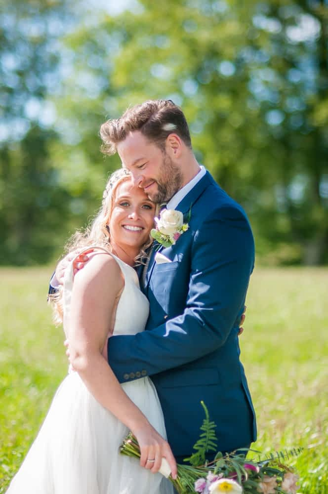 Snuggling in for a cuddle, Overwater Hall wedding, Lake District