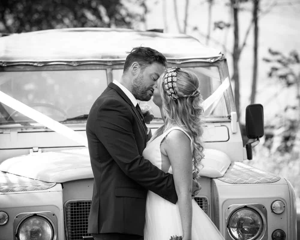 Kissing in front of the Land Rover