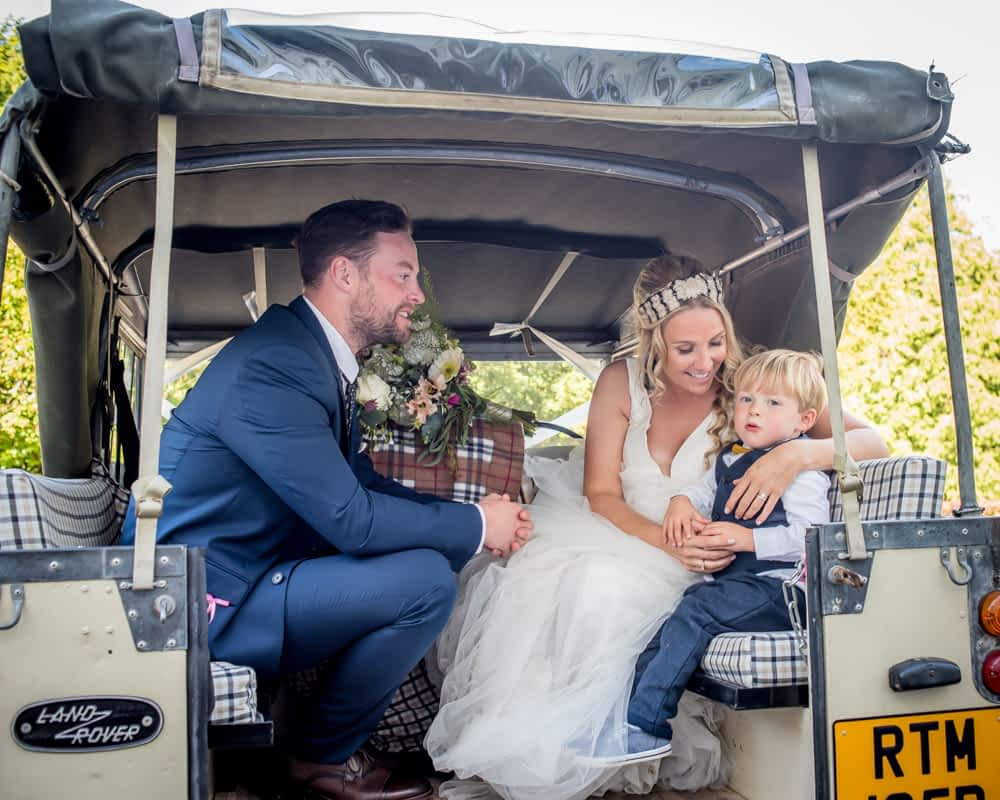 Cuddles with Callan in the Land Rover, Overwater Hall wedding, Lake District