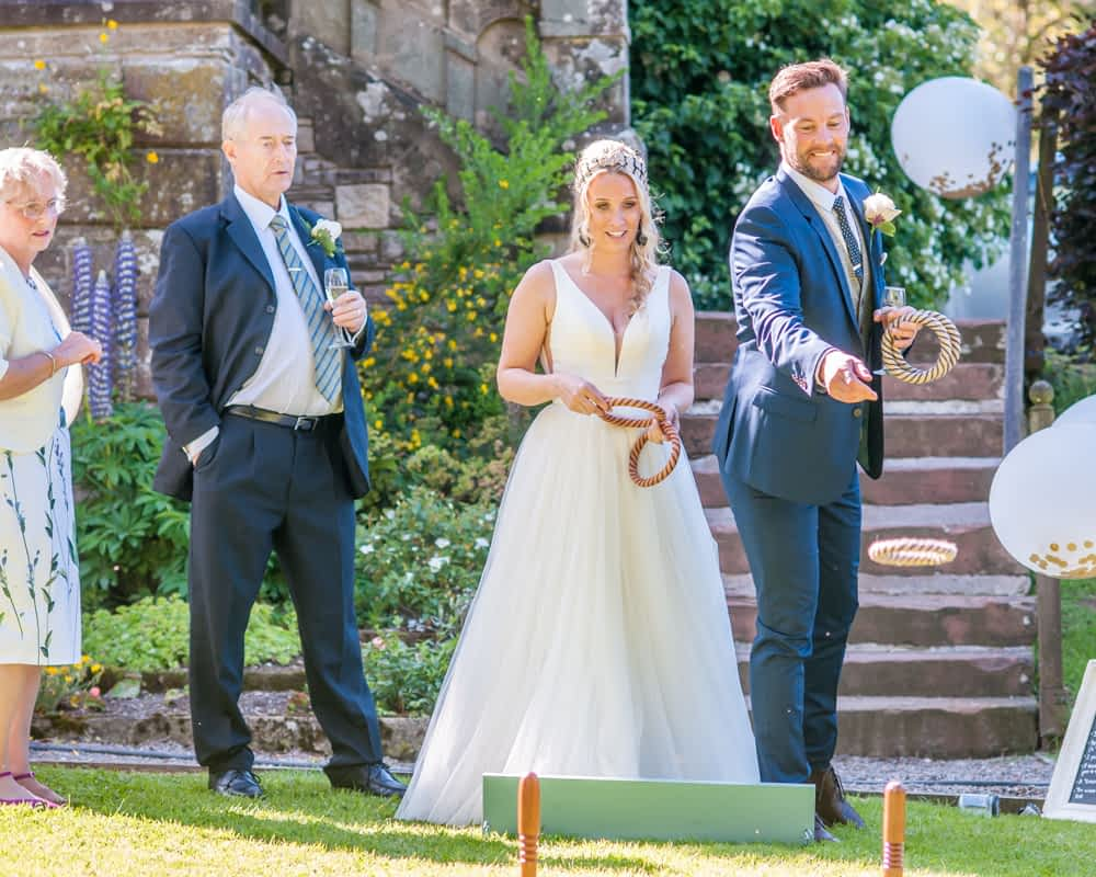 Bride and groom playing quiots, Overwater Hall wedding, Lake District
