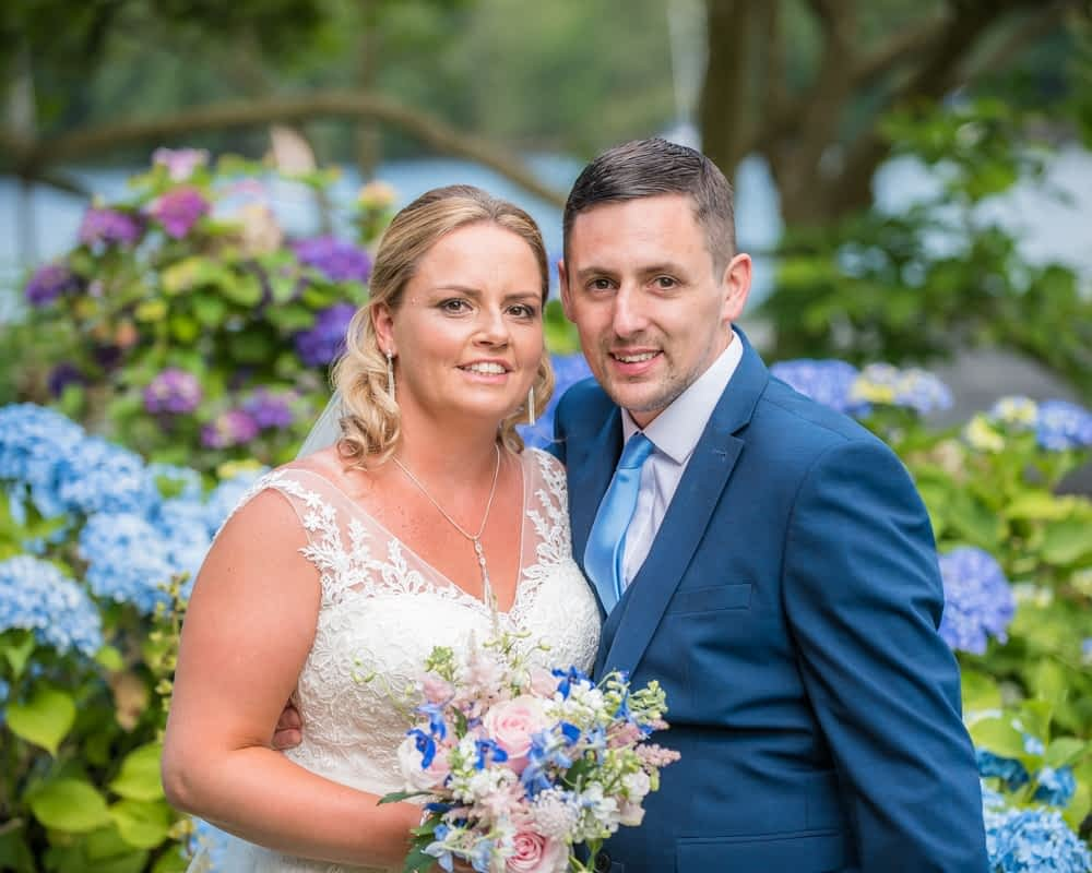 Bride and groom in the gardens of Lakeside Hotel, Windermere