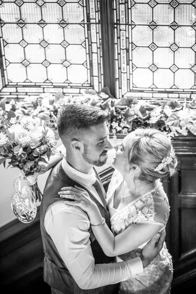 Together on the staicase,  wedding photographers Carlisle register office elopement wedding Lake District
