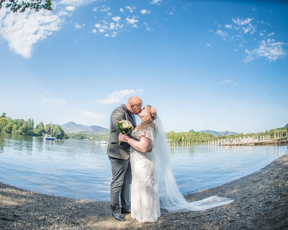 Kissing by the Lake, Derwentwater Rock the Dress, Lake District wedding photographer
