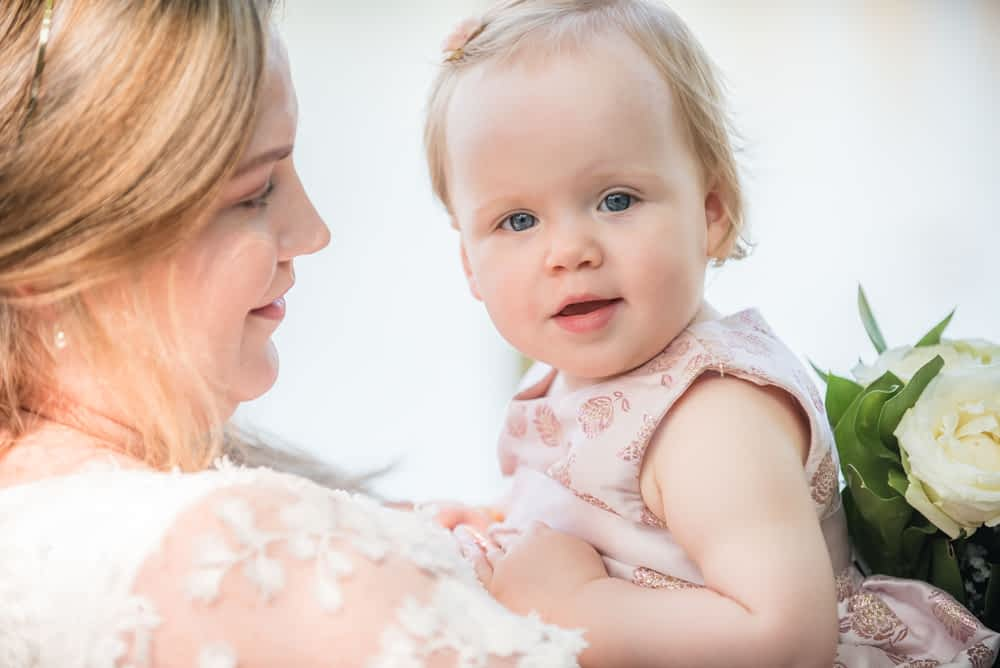 Baby smiling for camera, Derwentwater Rock the Dress, Lake District wedding photographer