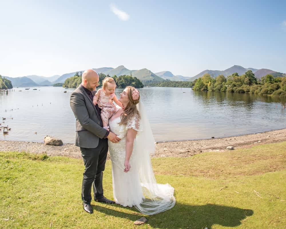 With the lake in the background, Derwentwater Rock the Dress, Lake District wedding photographer