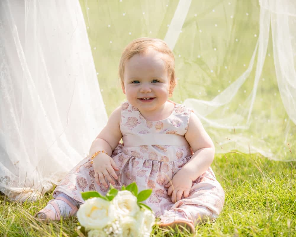 Baby hiding under wedding veil, Derwentwater Rock the Dress, Lake District wedding photographer