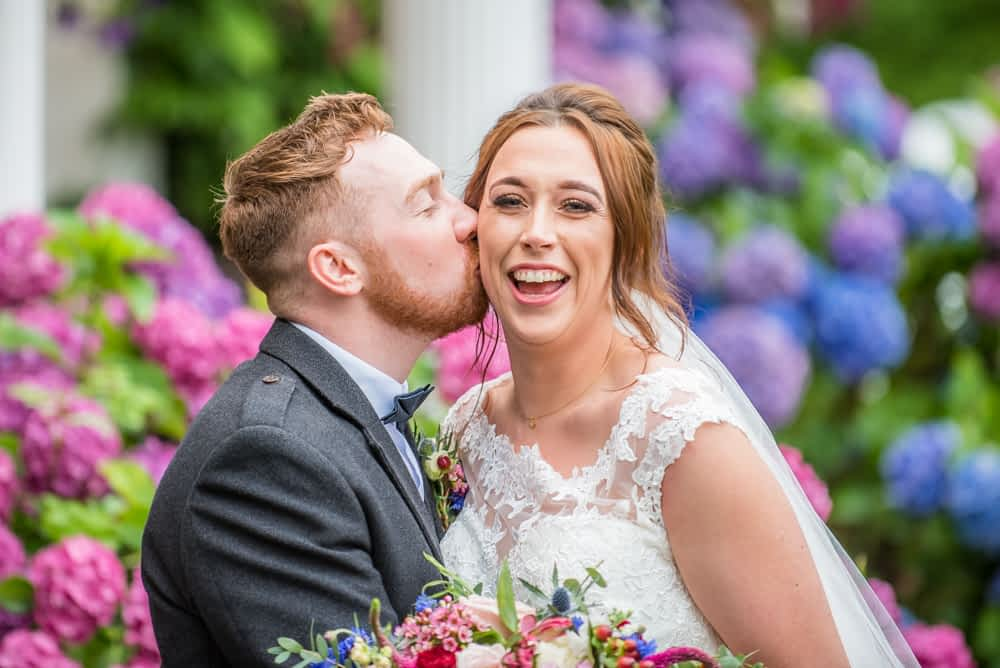 Kissing his new wife, laughter, Sheffield wedding photographers, Ringwood Hall Hotel
