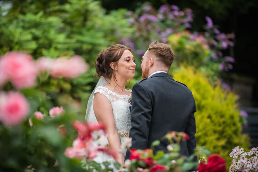 In the rose garden posing, Sheffield wedding photographers, Ringwood Hall Hotel