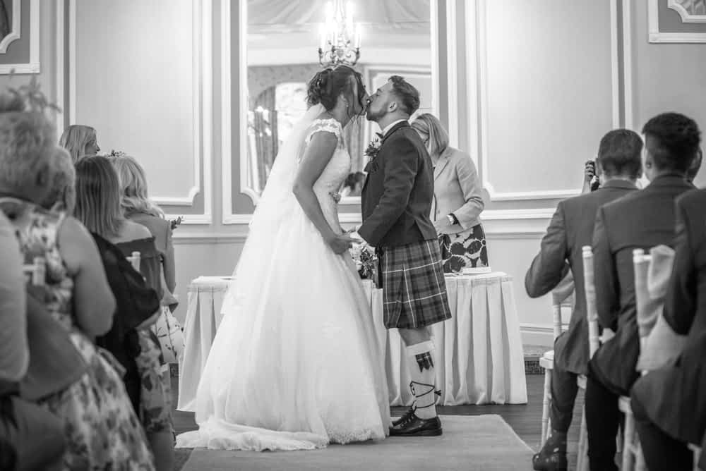 First kiss at wedding, Sheffield wedding photographers, Ringwood Hall Hotel