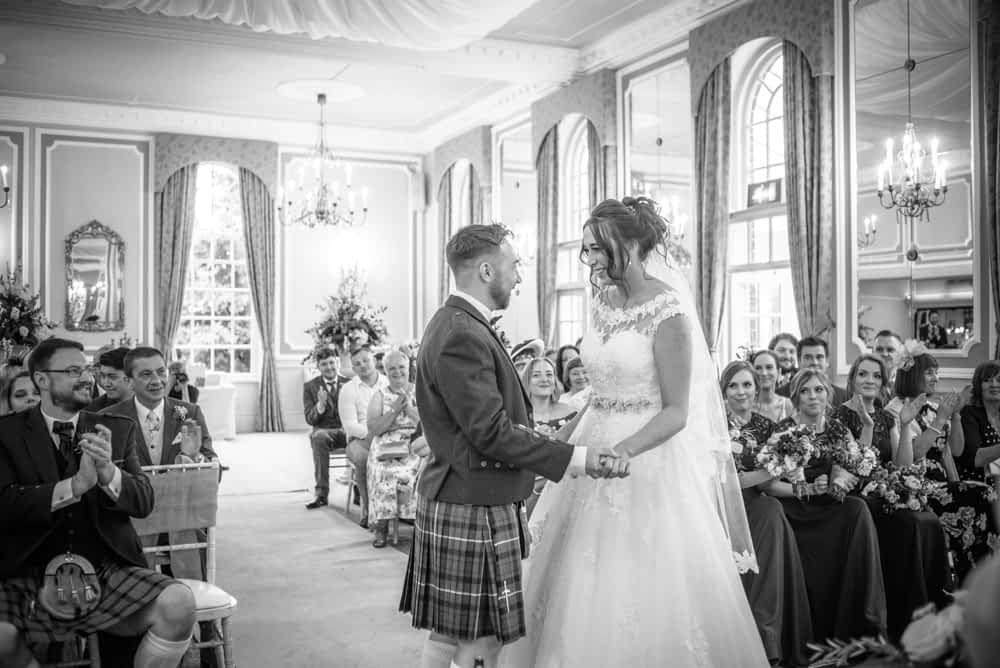 Groom in kilt - that just married laughter, Sheffield wedding photographers, Ringwood Hall Hotel