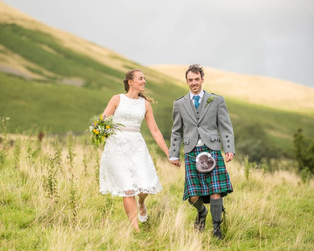 Walking with view of the fells, Howgills wedding, Sedbergh, Lake District wedding photographers