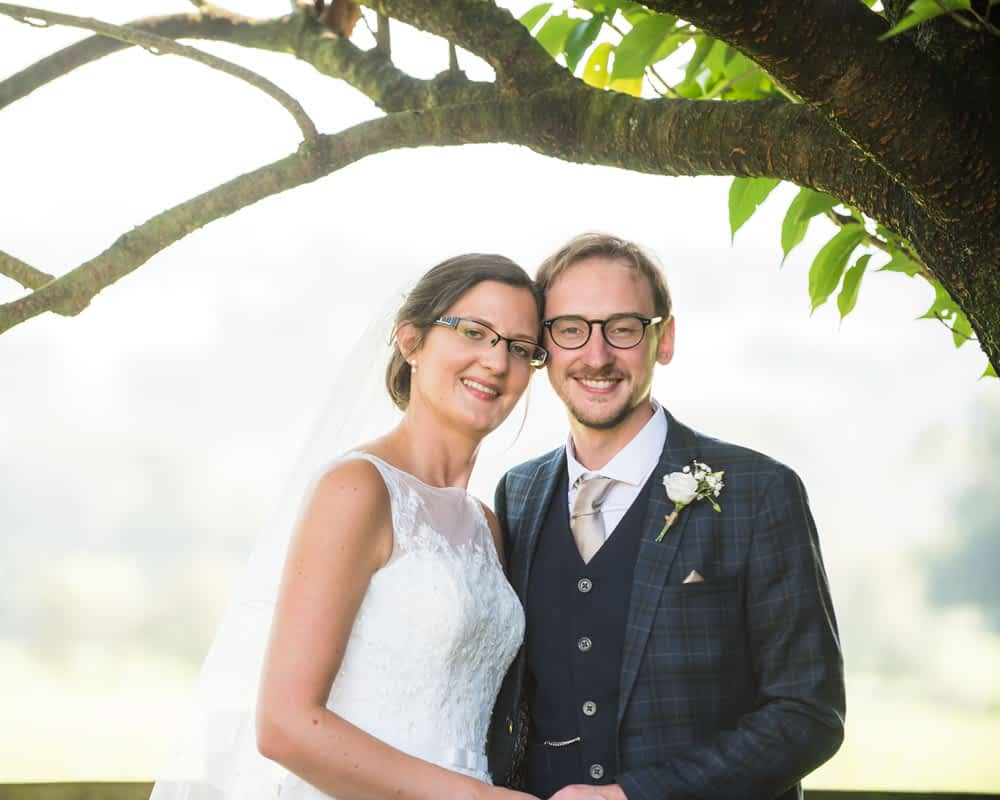 Bride and groom posing for camera, Shireburn Arms, Lancashire wedding photographers